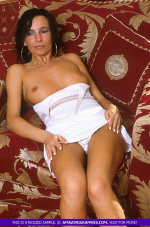 Luscious grandma pose her skinny body outdoor wearing her white dress and black high heels before she goes inside and expose her lusty boobs and nasty pussy in different positions on a maroon couch. - XXXonXXX - Pic 3
