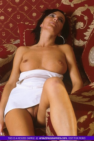 Luscious grandma pose her skinny body outdoor wearing her white dress and black high heels before she goes inside and expose her lusty boobs and nasty pussy in different positions on a maroon couch. - XXXonXXX - Pic 8