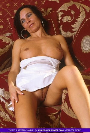 Luscious grandma pose her skinny body outdoor wearing her white dress and black high heels before she goes inside and expose her lusty boobs and nasty pussy in different positions on a maroon couch. - XXXonXXX - Pic 9