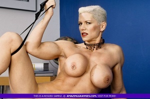 Muscular granny pose naked and reveals her big round tits and luscious pussy in different poses wearing her black high heels. - XXXonXXX - Pic 2