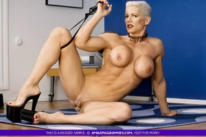 Muscular granny pose naked and reveals her big round tits and luscious pussy in different poses wearing her black high heels. - XXXonXXX - Pic 3