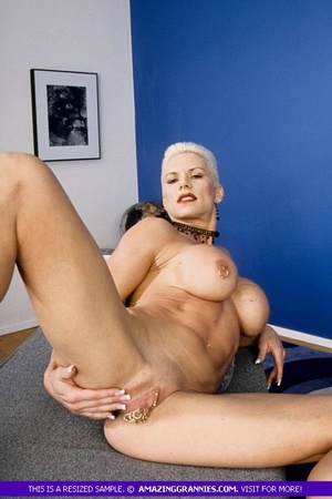 Muscular granny pose naked and reveals her big round tits and luscious pussy in different poses wearing her black high heels. - XXXonXXX - Pic 7
