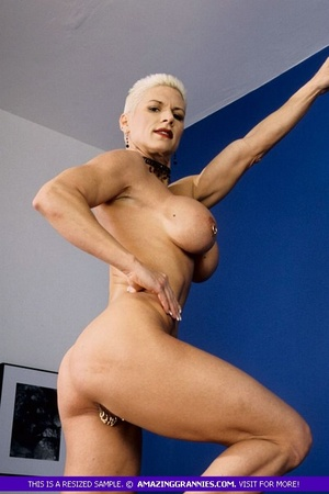 Muscular granny pose naked and reveals her big round tits and luscious pussy in different poses wearing her black high heels. - XXXonXXX - Pic 10