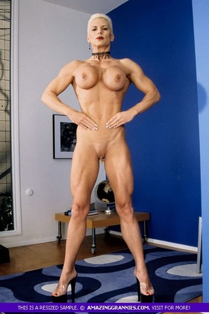 Muscular granny pose naked and reveals her big round tits and luscious pussy in different poses wearing her black high heels. - XXXonXXX - Pic 12