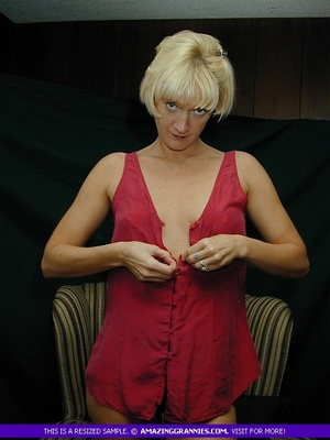 Mature blonde pose her alluring body then pulls down her red blouse and teases with her sweet boobs then peels down her black panty and expose her lusty pussy on a brown couch. - XXXonXXX - Pic 3