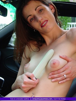 Steaming hot MILF pose naked and shows her small tits and skinny body while she drills her twat with a white dildo in a car. - XXXonXXX - Pic 1
