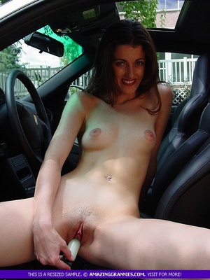 Steaming hot MILF pose naked and shows her small tits and skinny body while she drills her twat with a white dildo in a car. - XXXonXXX - Pic 7