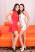 two brunettes dresses strip