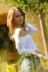 Pretty redhead in white gets her legs spread and fucked outside.