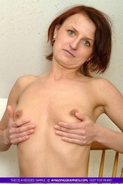 hot granny sits topless