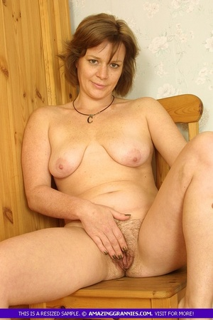 Luscious granny sits naked and displays  - XXX Dessert - Picture 2