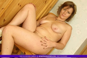 Luscious granny sits naked and displays  - XXX Dessert - Picture 11