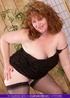 Foxy granny displays her fat body in black dress, stockings and high heels