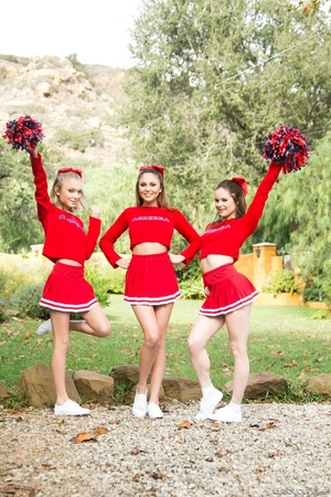 Three sexy teens in red cheerleader uniform and no panty teasing outdoors and flashing their naked goods - XXXonXXX - Pic 8