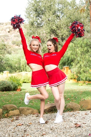 Three sexy teens in red cheerleader uniform and no panty teasing outdoors and flashing their naked goods - XXXonXXX - Pic 9