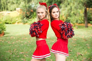 Three sexy teens in red cheerleader uniform and no panty teasing outdoors and flashing their naked goods - XXXonXXX - Pic 10