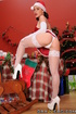 White stockings and Santa hat brunette gets fucked from behind