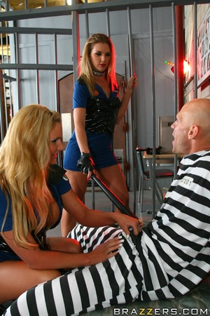 Two blonde police officers torturing a big-dicked prisoner - XXXonXXX - Pic 11