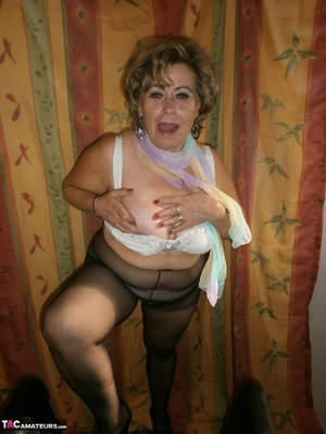 Hot ass MILF is wearing nylon pantyhose while playing with her natural boobs - XXXonXXX - Pic 12