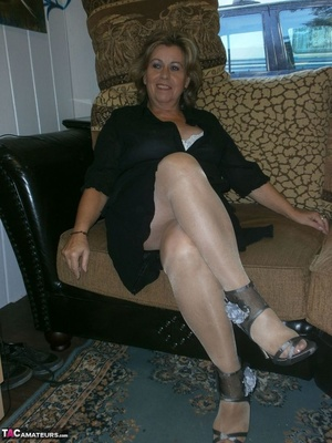 Voluptuous blonde MILF shows her large tits to the cam and poses in nylon pantyhose - XXXonXXX - Pic 1