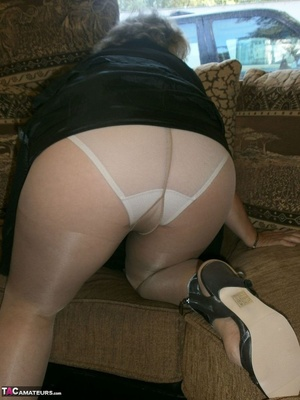 Voluptuous blonde MILF shows her large tits to the cam and poses in nylon pantyhose - XXXonXXX - Pic 3