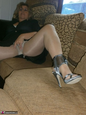 Voluptuous blonde MILF shows her large tits to the cam and poses in nylon pantyhose - XXXonXXX - Pic 5