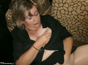 Voluptuous blonde MILF shows her large tits to the cam and poses in nylon pantyhose - XXXonXXX - Pic 7