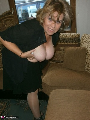 Voluptuous blonde MILF shows her large tits to the cam and poses in nylon pantyhose - XXXonXXX - Pic 8
