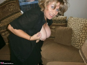 Voluptuous blonde MILF shows her large tits to the cam and poses in nylon pantyhose - XXXonXXX - Pic 9