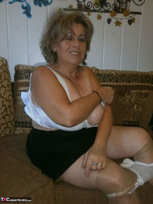 Voluptuous blonde MILF shows her large tits to the cam and poses in nylon pantyhose - XXXonXXX - Pic 13