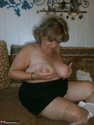 Voluptuous blonde MILF shows her large tits to the cam and poses in nylon pantyhose - XXXonXXX - Pic 14