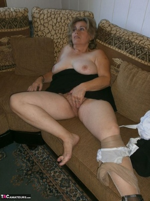Voluptuous blonde MILF shows her large tits to the cam and poses in nylon pantyhose - XXXonXXX - Pic 16