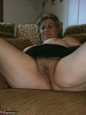 Voluptuous blonde MILF shows her large tits to the cam and poses in nylon pantyhose - XXXonXXX - Pic 18