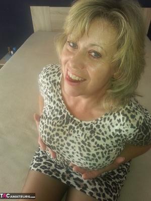Beautiful blonde milf is posing in sexy dress and nylon stockings - XXXonXXX - Pic 3