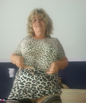 Beautiful blonde milf is posing in sexy dress and nylon stockings - XXXonXXX - Pic 10