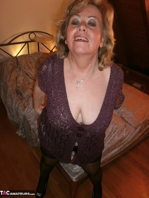 Smiling blonde cougar is fingering her snatch, while wearing nylon pantyhose - XXXonXXX - Pic 1