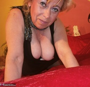 blonde milf plays with