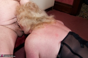 Mature blonde bitch is wearing sexy black nylons while having a cock in her mouth - XXXonXXX - Pic 2
