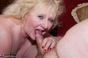 Mature blonde bitch is wearing sexy black nylons while having a cock in her mouth - XXXonXXX - Pic 5