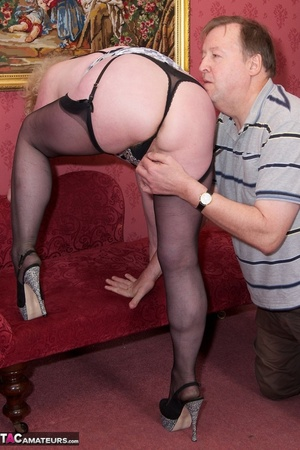 Mature blonde bitch is wearing sexy black nylons while having a cock in her mouth - XXXonXXX - Pic 6
