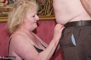 Mature blonde bitch is wearing sexy black nylons while having a cock in her mouth - XXXonXXX - Pic 16