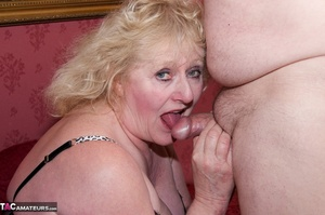 Mature blonde bitch is wearing sexy black nylons while having a cock in her mouth - XXXonXXX - Pic 19