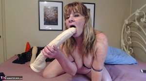 Stunning milf with big breasts is fucking her twat with a huge dildo - XXXonXXX - Pic 13