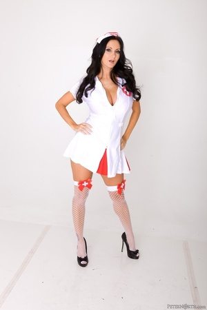 Long-haired nurse shows the red bra and panty set hidden under her uniform. - XXXonXXX - Pic 4
