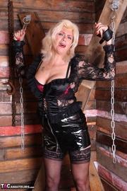 blonde older mistress binds