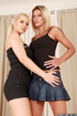 High heeled blonde in white heels and black outfit posing with her mate