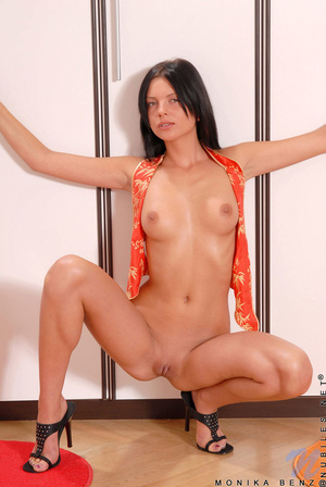 Wild brunette with an orange outfit fingers her pussy while laying on the floor - XXXonXXX - Pic 6