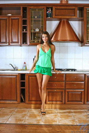 Stunning tanned brunette in green eats her oranges before banging herself in the kitchen - XXXonXXX - Pic 1
