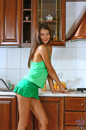 Stunning tanned brunette in green eats her oranges before banging herself in the kitchen - XXXonXXX - Pic 2