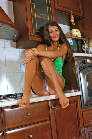 Stunning tanned brunette in green eats her oranges before banging herself in the kitchen - XXXonXXX - Pic 5